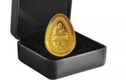 В Канаде выпустили золотую монету в форме украинской писанки