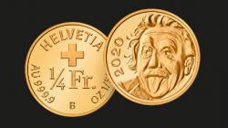 Швейцария отчеканила самую маленькую в мире золотую монету